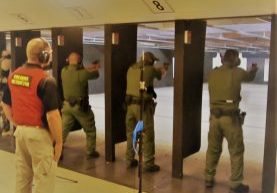 Federal_law_enforcement_officers_during_firearms_training_exercises_at_indoor_firing_range (2)